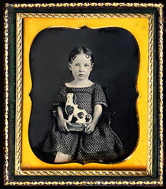 daguerreotype of a girl with a chalkware toy in the form of a Staffordshire Cavalier King Charles Spaniel